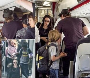 Brad Pitt and Angelina Jolie travel economy class with children