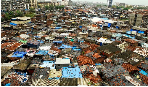 Dharavi slum, one of the largest in the world, attracts Tourists & Filmmakers